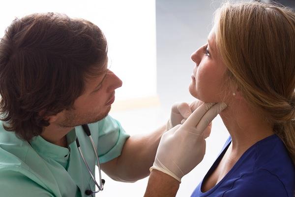 GP examining woman