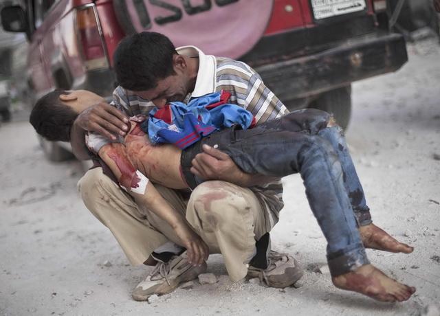sirija- rat- otac- decak- dete